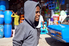 market portrait (simon-r-) Tags: ethiopia éthiopie äthiopien addisababa addisabeba addis 2017 africa afrique afrika afriquedelest eastafrica ostafrika portrait photography market bazaar boy scene city life street travel documentary sholamarket african إثيوبيا أفريقيا سوق sony alpha ilce 5000