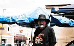 Biker Larry ,OLearys Pub & a Beer (Shot by Newman) Tags: laughlinnv bullheadcityaz laughlinriverrun bikeweek bikerlarry hat shotbynewman mojavedesert southwestus fuji400 fujifilm 35mm daylight 35mmminolta beer
