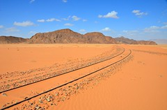 Railroad of Arabia (Pedestrian Photographer) Tags: wadi rum desert train tracks feb february 2018 dsc8482 sand red deserted rail railroad blue sky mountains mt mts merge converge sandy distance ribbet hejaz railway ww1 worldwarone