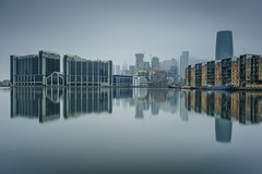 Shrouded in Mystery... (Aleem Yousaf) Tags: shrouded mystery nikkor dawn fog mist waterfront contrast town bay reflections paisaje smile world canary wharf buildings ship flickr water millwall outer docks colorful long exposure nikon d810 2470mm little stopper graduated neutral density filter sky architecture grey moody morning photography modern building tower skyscraper construction cranes skyline cityscape docklands east london e14 mirror image digital vignette floating debris