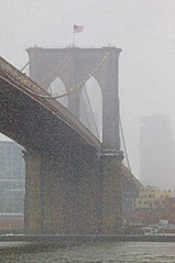 Heavy Snow in New York (emmett.hume) Tags: brooklynbridge bridge newyork urban harbor snow water flag storm blizzard city brooklyn span eastriver river impressionism cold suspension icon architecture cable landmark history precipitation evening northeaster inclemency stone arch waterfront america wind gale ice resilience fortitude endurance banner red brown stability faith optimism loyalty patriotism integrity 1025fav