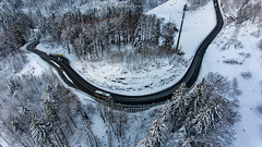 Road curve (Silvan Bachmann) Tags: switzerland swiss suisse lungern brünig bern road curve bend forest snow winter white cold cars nature landscape view drone dji phantom