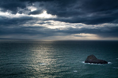 A light in the storm (shutterbug314) Tags: storms sea sky ocean water rock bay landscape