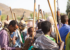 Oromo men and boys with sticks, Canes and weapons dancing and celebrating happily a wedding, Oromo region, Sambate, Ethiopia (berengere.cavalier) Tags: abyssinia adult adults africa african ak4 ak47 blackethnicity blackpeople blackskin canes celebrate celebrating celebration celebrations ceremony cheerful cheerfully color day eastafrica ethio1655 ethiopia ethiopian ethnicity etnic etnicgroup family friends groupofpeople gun happily happiness horizontal hornofafrica joy joyful kalachnikov kamise lifeevent marriage onlymen oromia oromo outdoor outdoors parents relatives sambata sambate sembate sticks togetherness tradition traditional traditionalceremony traditionalculture tribal tribe weapon wedding weddingceremony oromoregion