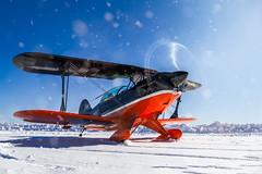 Winter flying (hepic.se) Tags: winter snow sun reflection flare snowflake sunrays pilot propeller plane pitts disc biplane backlight blue light aircraft aviation airplane aerobatics aeroplane sweden nose ground white lycoming cockpit sky propblur