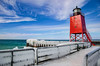 Icy Railing under Blue Skies (T P Mann Photography) Tags: lake lakemichigan michigan ice waves sea pier railings cold winter sun red lighthouse charlevoix