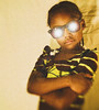 d5 (Snappr007 (Winston Tinubu)) Tags: eyesglasses girl unique africankid portrait pose award snappr007 kid african shining glare special good