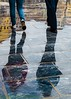 Reflection (old.pappous) Tags: chania crete greece hania feet harbour harbourside pedestrian people storm walker waterfront weather