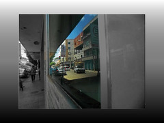 Reflections of the city ... (Guilherme Alex) Tags: glass mirror reflection reforms life live people sun day morning monday my city cityscape walking perspective person window angle digitalcamera amateur march imperfection buildings focus amazing shot beautiful wonderful colorful cutout blackandwhite cars wheels frame art natural light sidewalk street small brazil minas gerais teofilo otoni traffic busy design red