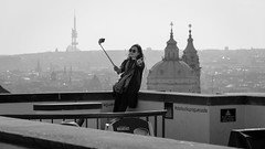 The Sky over Prague (Torsten Reimer) Tags: castle czechrepublic europa cityscape tschechien czechia frau selfie selfpotrait woman prag selfiestick prague schwarzweis europe tourists blackandwhite cz