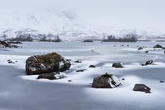 Loch Ice and Snow Streaks (Geoff France) Tags: landscape scottishlandscape highlands loch lake mere water ice snow mountains mist boulder rocks