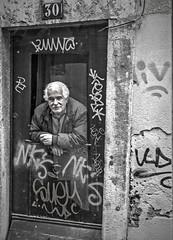 No. 30 (slavamanc) Tags: man old graffiti candid face expression window oldbuilding street city urban portrait monochrome blackwhite lisbon panasonicdmcgx80
