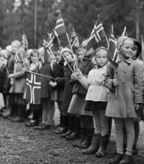 Parade (theirhistory) Tags: children boys kids school class form flag coat group dress skirt shoes wellies boots