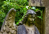It's Her Natural Hair Colour (Steve Taylor (Photography)) Tags: angel cross memorial tribute statue brown green sad woman lady uk gb england greatbritain unitedkingdom london ivy leaves cemetery wings cemetry graveyard highgate highgatecemetry