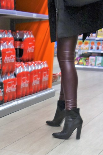 Rosina in the shopping mall in red leather leggings and