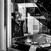 Frank's (Kieron Ellis) Tags: blackandwhite blackwhite monochrome street woman shop money window chicken