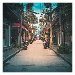Endless Alley (Alex E. Milkis) Tags: kohphangan street alley thailand harbor vignete sunset cloudy fade wide beautiful tones vacation explore exotic national d810 2470 postprocess imagine travel best moment land water sky road walk