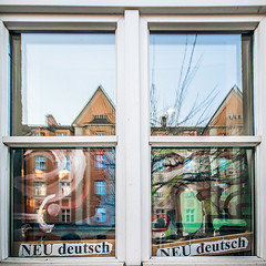 Neu (Melissa Maples) Tags: münchen munich deutschland germany europe nikon d3300 ニコン 尼康 sigma hsm 1020mm f456 1020mmf456 winter square 11 reflection window neudeutsch text sign