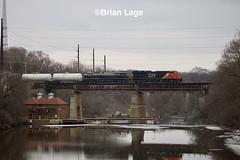 L571 IA Falls (eslade4) Tags: tankcar cn iowafalls canadiannationalrailway l571 cn3065 ns8101 centralofgeorgia bridge reflection heritageunit