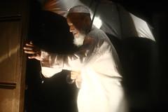 Who's The Gate Crasher Now ! (N A Y E E M) Tags: taher securityguard umbrella night light availablelight ramadan rain monsoon gate home rabiarahmanlane chittagong bangladesh windshield sooc raw unedited untouched