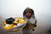 Portrait of a Flower Seller Boy (pallab seth) Tags: varanasi people tradition morning ganga river banaras india ganges culture asia candid winter fog mist boy flowerseller