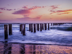 Sunset over the Pilings (mjhedge) Tags: naples florida pilings gulfofmexico gulf beach sand water sunset sky getolympus olympus oly omdem1mkii em1mkiiomdem1markii mzuiko12100mmf4pro 12100mm 12100mmf4 longexposure