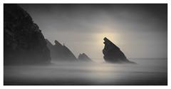 Surf Fishing (Vesa Pihanurmi) Tags: seascape beach rocks cliff fisherman surffishing monochrome portugal sintra praiadaadraga