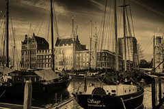 Veerhaven Rotterdam (STEHOUWER AND RECIO) Tags: veerhaven rotterdam sepia harbour marina boats buildings water sailboats marine historic historical history ships sailing light sunrise sky netherlands holland dutch monochrome sony dscrx100 reflections masts mast architecture architectuur windows window raam vintage retro city old river classic mono photo photography capture image