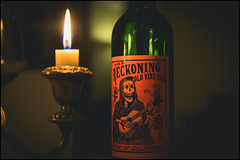 Beware the Reckoning (G. Postlethwaite esq.) Tags: dof derbyshire macro beyondbokeh bokeh bottle candle closeup depthoffield flame fullframe glass photoborder selectivefocus tincture wine red vino cureall california