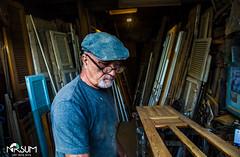the carpenter (tchia sheffer) Tags: carpenter workman working blue hat woods atelier workshop one