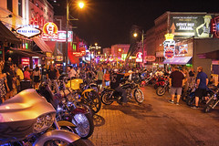 Bike Nights on Beale Street - Memphis (Tennessee) (Andrea Moscato) Tags: andreamoscato america statiuniti usa unitedstates us city città downtown dark darkness night nightlife notte notturno shadow ombre light luci street strada road town red yellow pub sign bike people persone buildings edificio shop black vivid