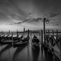 early morning (hjuengst) Tags: venice venedig venezia italy italien italia blackandwhite schwarzweis gondola gondel streetlight lantern strasenlampe sunrise sonnenaufgang wolken clouds