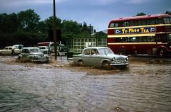 Rawtenstall,  Lancashire -  1964 (Lawrence Peregrine-Trousers) Tags: rossendale lancashire flood flooding cars motors 1960s motoring hillman minx audax series 2 3 ii iii 3a iiia leyland titan pd2 rawtenstall corporation