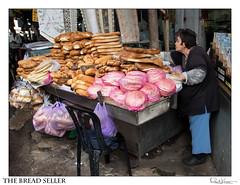 The Bread Seller (Raul Kraier) Tags: bread seller baker post shuk hacarmel telaviv woman