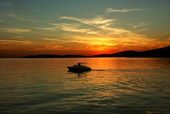 Speed boat's sillouette at dusk - Croatia. Stock Photo