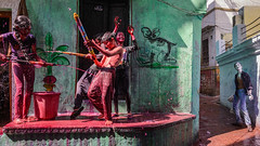 Holi mood (SaumalyaGhosh.com) Tags: holi mood fun enjoyment environment gali street streetphotography colors water bucket graffiti wall lane india benaras varanasi