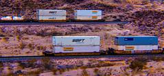 Trucking Wars (Woodypug) Tags: swift jbhunt trucking atsf tofc cofc piggyback trains railroad kingmancanyon arizona bnsf