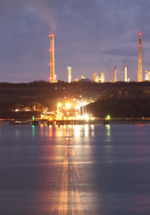 Refinery (Raphooey) Tags: gb uk wales south west southwest pembrokeshire pembroke milford haven sea seaside seashore shore shoreline water dock docks harbour wave waves oil refinery ship ships jetty wharf wharfslight lights cloud clouds night evening dusk reflection reflections canon eos 80d chimney chimneys stack stacks
