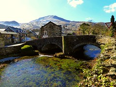 Beddgelert village (lesleydugmore) Tags: river water rock stone blue green houses bridge mountain wall tree beddgelert northwales outside outdoor greenery