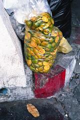 Squeezed (ADMurr) Tags: daa074 bag citrus rinds squeezed red yellow green leica m6 kodak ektar bangkok