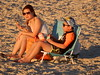 Sunshine Snack (mikecogh) Tags: grange beach sunlight comfortable snack mother son sunglasses