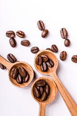 Brown roasted coffee beans (sector71) Tags: coffee bean brown roasted espresso background drink caffeine seed dark food aroma white energy black cafe closeup ingredient mocha isolated agriculture beverage cappuccino macro gourmet flavor natural grain nobody color breakfast aromatic freshness texture arabic backdrop coffe crop heap roast morning textured image scented group hot space spoon