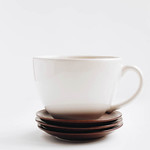 Big white cup and dessert plates on white background. thumbnail