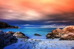 The Beach (Yarin Asanth) Tags: calaagulla calaratjada calarajada water beach rock bolders longexposure orange blue sea ocean mallorca baleares yarinasanthphotography gerdkozikfotografie