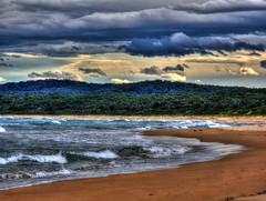 Stark beach scene (elphweb) Tags: hdr highdynamicrange nsw australia seaside beach beachy sand sea ocean water sky skies clouds cloud sun sunset colourful colorful color colour