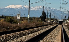 Athens Suburban Railway with view to Parnassos mountain (jimiliop) Tags: railway mountain cables lines tunnel iron rock perspective long signs athenssuburbanrailway greece greekrailways telescopelens