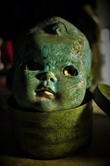 West Virginia baby (Twila1313) Tags: doll dollhead creepy green old plastic movingeyes westvirginia found haunted scary odd panasonicgf1