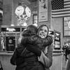 10:15 AM (John St John Photography) Tags: grandcentralterminal streetphotography candidphotography 42ndstreet vanderbiltavenue lexingtonavenue newyorkcity newyork informationdesk clock people peopleofnewyork embrace hello greeting americanflag travellers bw blackandwhite blackwhite blackwhitephotos johnstjohn