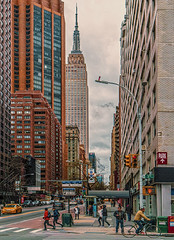 """Street Scene In Midtown Manhattan (View of Empire State Building) (nrhodesphotos(the_eye_of_the_moment)) Tags: dsc0943123001084 """"theeyeofthemoment21gmailcom"""" """"wwwflickrcomphotostheeyeofthemoment"""" manhattan nyc midtown 34thstand3rdave pedestrians autos people buildings outdoors architecture landmark empirestatebuilding windows reflections shadows crosswalk"""