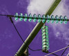 Insulators of electric pylons. (Lise1011) Tags: electric color purple isolators abstract clouds object volt line technology cable ceramic sky green vert electricity pylon voltage